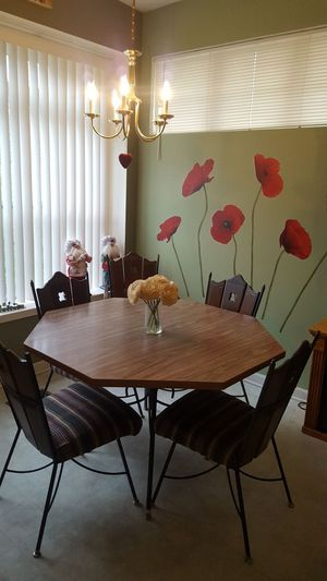 Wrought iron octagon kitchen table with four wrought iron and wooden chairs. It is for pick up only. for Sale in Cleveland, OH