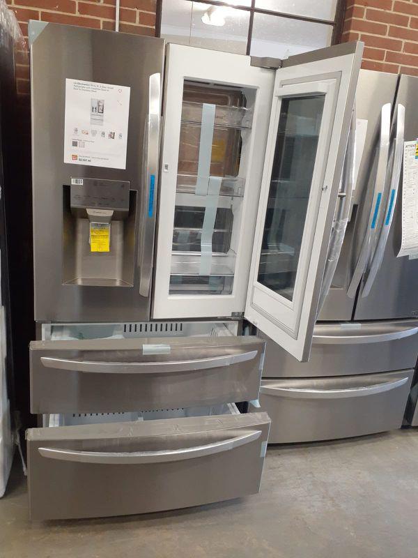 Brand new LG 4-doors refrigerator with instaview door in door and 2 freezer drawers