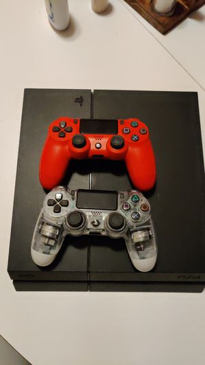 PS4 2 remotes 1 game for Sale in Arlington, TX