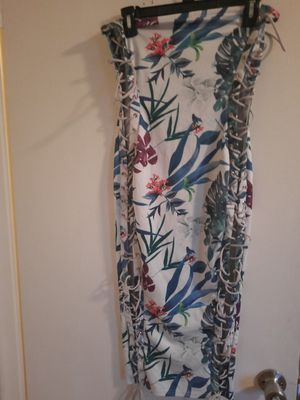 Ladies flowers dress size medium, wear one, the dress strap on both sides. Pet and smoke free home. for Sale in West Palm Beach, FL