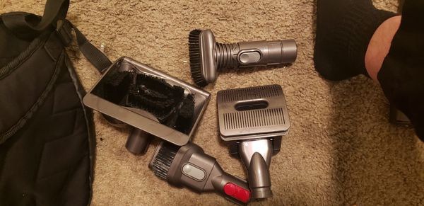 Dyson DC 65 vacuum with brand new attachments