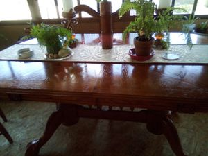 Claw dining table with four teal upholstery chairs for Sale in Oroville, CA