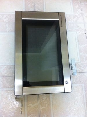 GE Microwave Door with brackets Measurements are in are in the pictures 17in X 11in roughly for Sale in Houston, TX