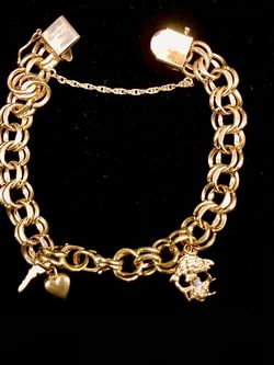 """14K Gold Custom link bracelet with charms w Diamond 7"""" long 30.75grm no trades pick up in Tacoma for Sale in Tacoma,  WA"""