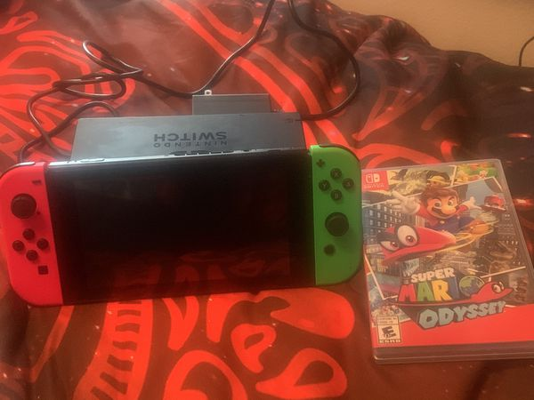 Nintendo Switch Console with Neon Green and Neon Red Joy-Con controller and bonus game Super Mario Odyssey ! Retails for 489.90!