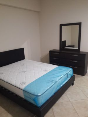 New queen bed frame and mirror dresser mattress is not included for Sale in Pompano Beach, FL
