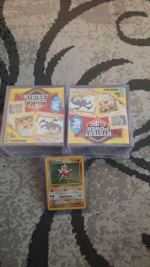 Pokemon 2 Mystery Power cubes & vintage Holo Hitmonchan! for Sale in Virginia Beach, VA