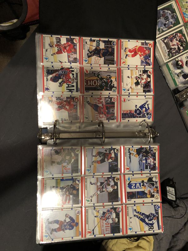 Baseball football and hockey collector cards