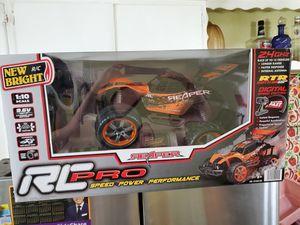 New Bright Rc Pro Orange Remote Controlled Car for Sale in Pico Rivera, CA