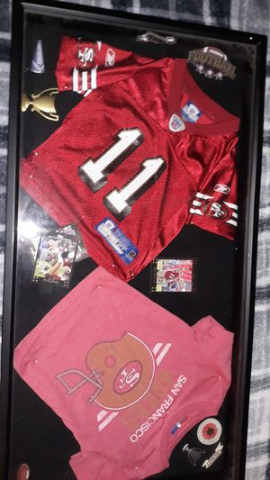 Picture box w toddler size jersey ant T for Sale in Hemet, CA