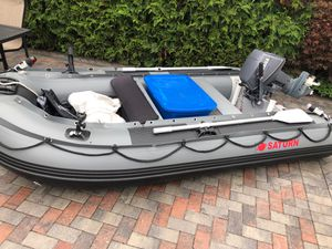 Saturn boat inflatable with motor Yamaha Plus paddles The boat has wheels4 rod holders for Sale in Baldwin, NY