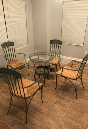 Dining set with glass tabletop, base, and four chairs for Sale in Atlanta, GA