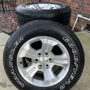 2015 Chevrolet Silverado stock Rims and tire set of 4( p265/65r18) Rims in pristine condition Tires still have a good amount of tread for Sale in Mooresville, NC