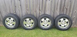 Four size 18 Toyota Tundra rim and tires for Sale in Mobile, AL
