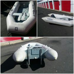 Inflatable boat with wooden bottom and wheels for Sale in West Bridgewater,  MA