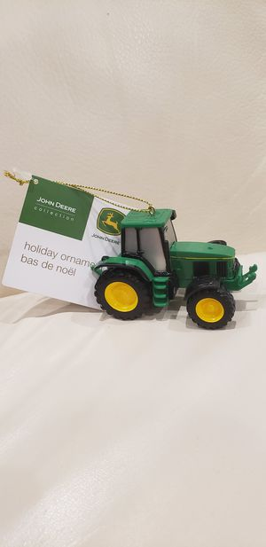 "John Deere tractor holiday Christmas tree ornament 3.5"" new with tags see photos as part of the description. Green yellow and black trademark tractor. for Sale in Ontario, CA"