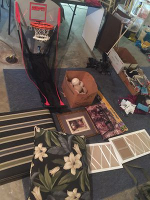 Basketball hoop keeps score 20$ cushions both for 15, picture frames both 5 softballs all for 10 for Sale in St. Peters, MO