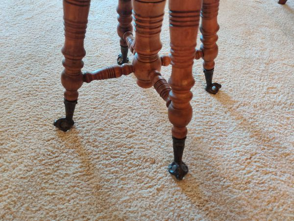 Antique swivel clawfoot ball piano stools