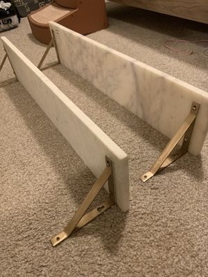 World Market white marble wall shelves with gold metal brackets for Sale in Portland, OR