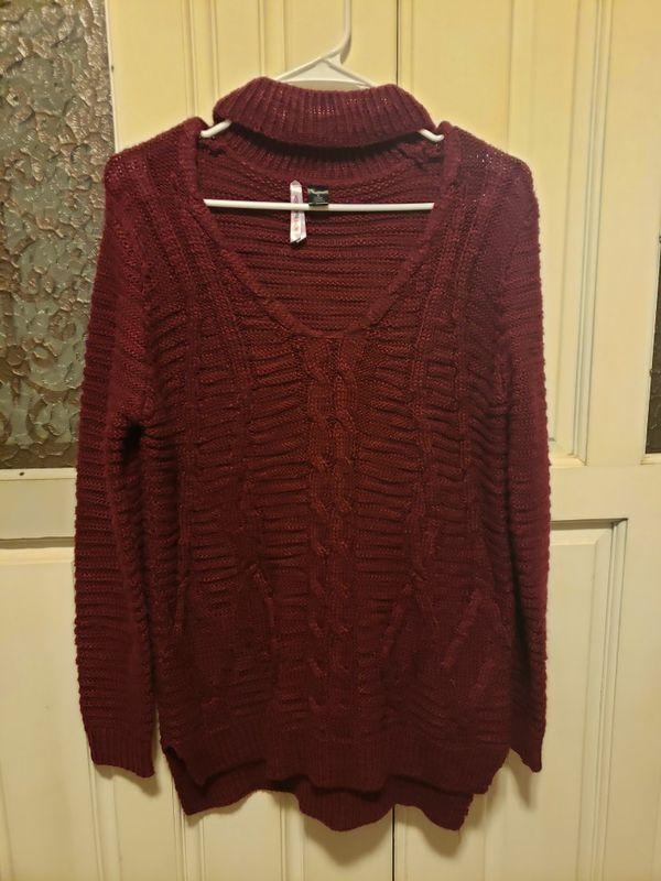 New sweater never worn size medium