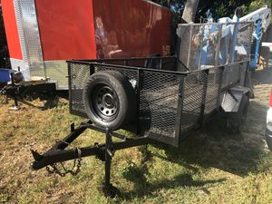 Flat trailer with gate and spare tire 5'x10' for Sale in Belleair, FL
