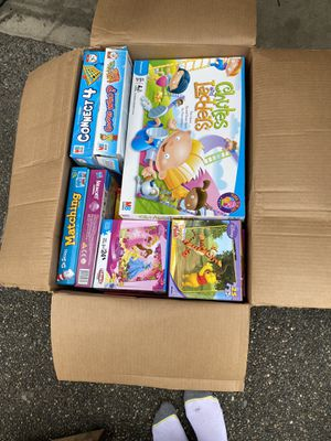 Big box of puzzles, coloring books, and family games for Sale in Silverdale, WA