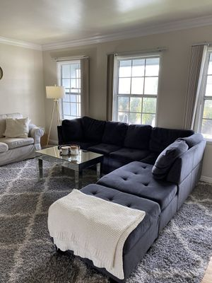 Grey/navy blue sectional sofa/couch with chaise and ottoman for Sale in Long Beach, CA