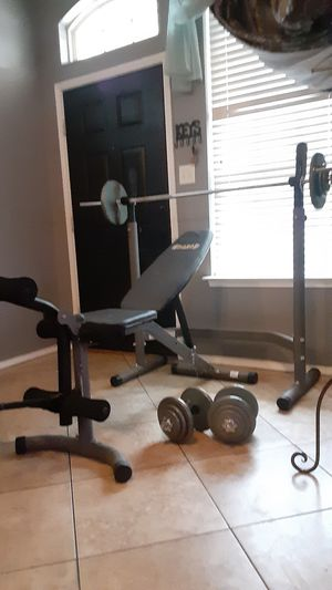 Bench press /squat rack with weights and barbells for Sale in Saginaw, TX