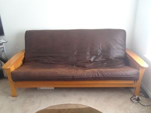 Futon frame is real wood strong sturdy with mattress like a leather matieral full size..both sides open up just opened 1side so you could see for Sale in Palm Bay, FL