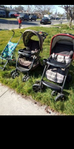 Strollers, clothing, Elsa, toy box, toddler tent, diapers, bow holder, Legos, kids DVDs, feeding chairs, ride on toys, baby bath and more for Sale in Fresno, CA