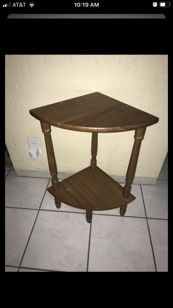 Small wooden corner shelf / plant stand. Small holes in top from missing rail $15