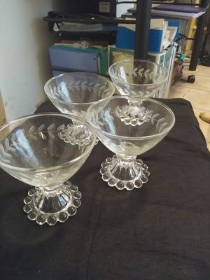 5 COLLECTIBLE WINE GLASSES/4 SAME/1 SMALLER for Sale in Fort Myers, FL