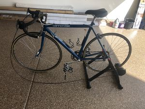 Cannondale aluminum road bike, and the trainer. for Sale in Chula Vista, CA