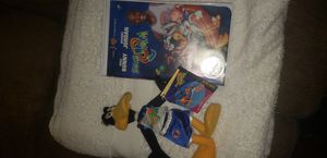 Space Jam VHS w/Coin and Daffy Toy for Sale in Chicago, IL