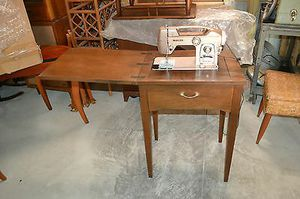 Modern home electric sewing machine antique in wooden cabinet for Sale in Jetersville, VA