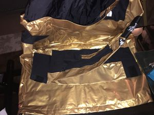 DS Supreme North Face Metallic gold Parka for Sale in Henderson, NV
