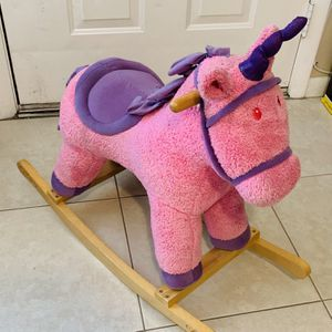 Pink and purple unicorn rocking horse for Sale in Hobe Sound, FL