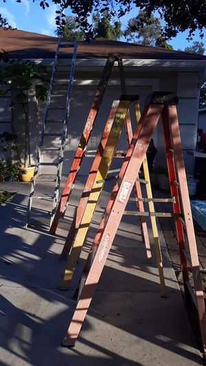 5 ladders including a 48 foot extension ladder for Sale in Fort Myers, FL