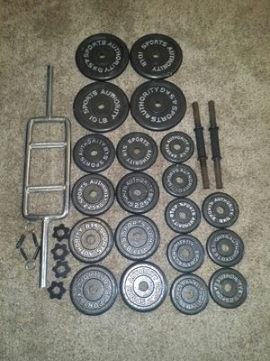 Weights 100lbs. 4x10lbs, 8x5lbs, 8x2.5lbs. Hammer curl bar and 2 dumbbell bars. Comes with 6 weight locks. for Sale in Deerfield Beach, FL