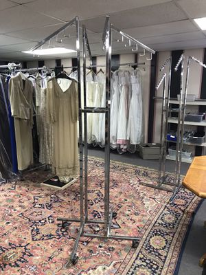 3 pc - four arm clothing racks. One with j-hook, two with waterfall style arms. Only two racks have wheels. Will to sell for $25 each or $75 for all for Sale in Mechanicsburg, PA