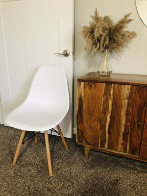 6 Modern mid century white plastic dining chairs wooden legs for Sale in Vancouver, WA