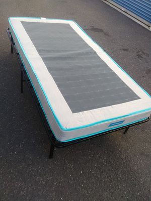 Twin size folding bed excellent new condition lightweight space saver ready for immediate use a couple curbside delivery possible for Sale in Philadelphia, PA