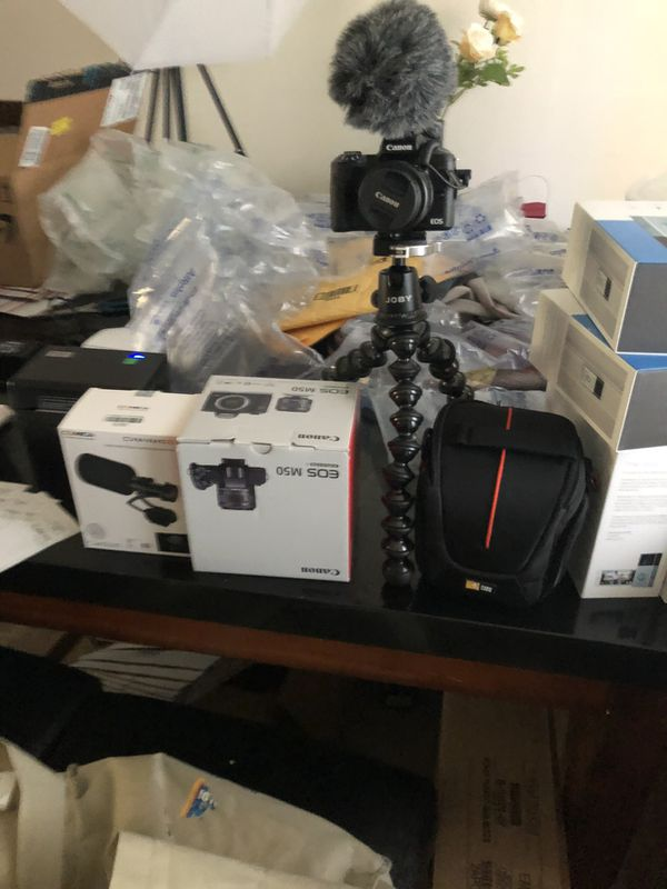 Canon m50 with 128gb sd card, joby gorillapod stand, microphone, camera bag, and box