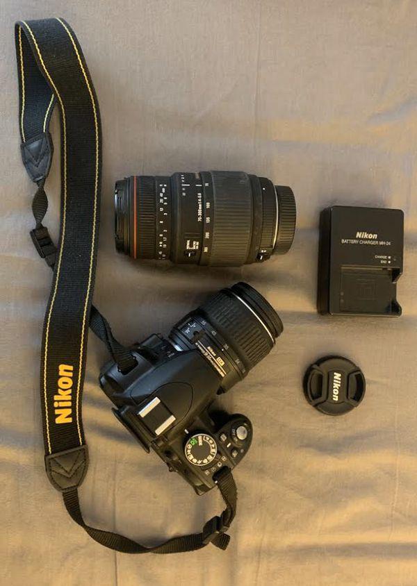 Nikon D3100 +two lenses +accessories