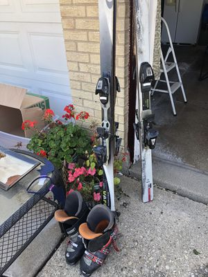 Two sets of Salomon skis and one pair of boots for Sale in Hanover Park, IL