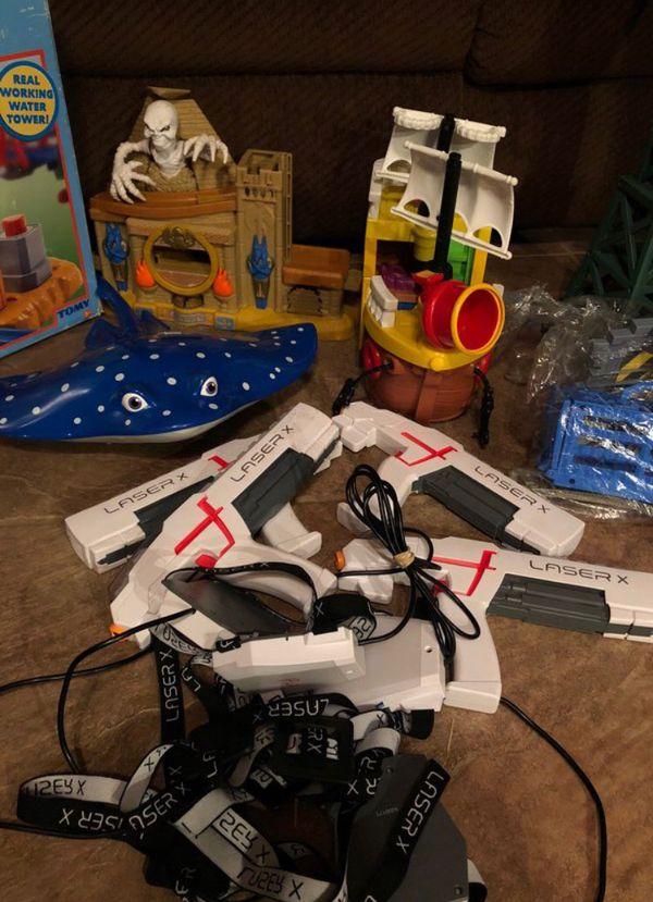 Lots of toys train sets and laser tag guns