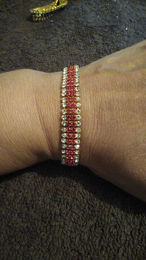 Brand new gold plated ladies bracelet with red and white stones $20 for Sale in San Antonio, TX