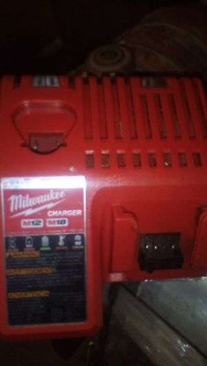 Milwaukee charger and grinder no battery $30 for Sale in Lakewood, CA