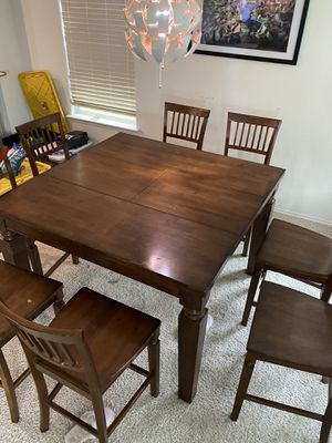 Ellington Nine pieces counter height dining table and chairs. for Sale in Austin, TX