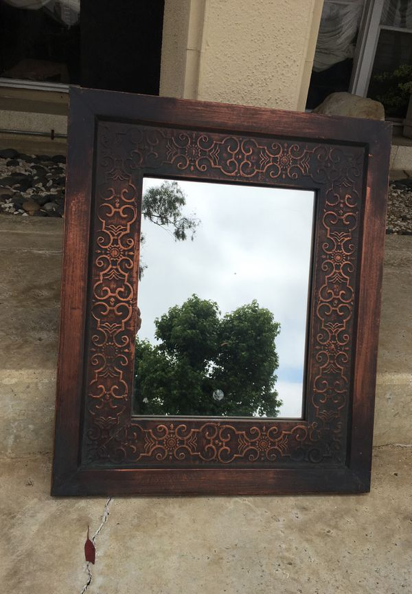 Hand forged metal wall mirror. 21x25. New.